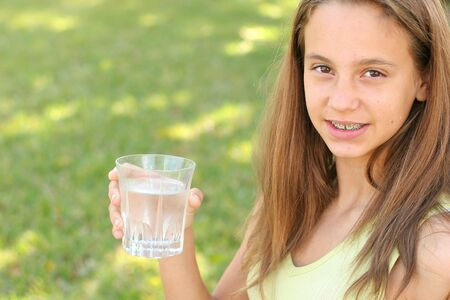 pre adolescents: young girl drinking a glass of water