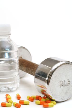 Bottled water with fitness weight & vitamins vertical photo