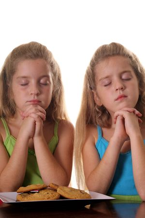 identical: Identical twin girls saying grace