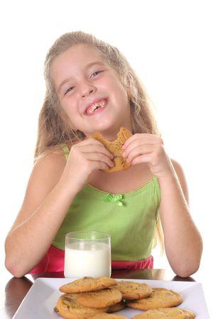 nibble: happy little girl eating cookies