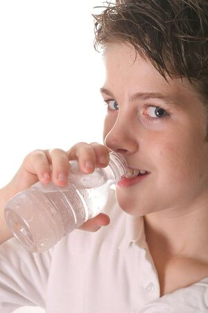 pre adolescent boys: young boy drinking water vertical upclose