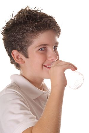 young boy drinking water vertical