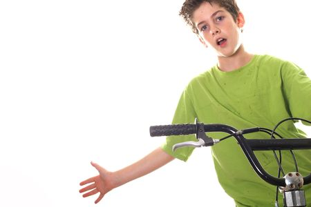 pre adolescent boys: young boy riding bicycle with hand out
