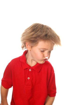 sharp focus on shirt, child shaking his head photo