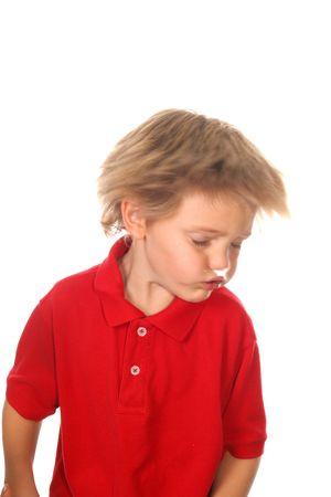 sharp focus on shirt, child shaking his head photo