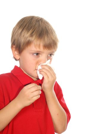 child blowing his nose photo