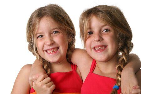 twin sisters hugging  photo