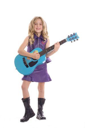 playing guitar: rockstar child playing guitar