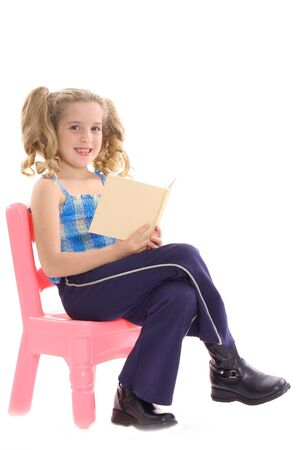 happy little girl reading a book 写真素材