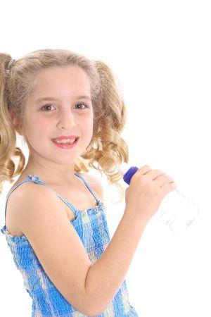 happy little girl drinking water 写真素材