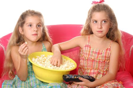 children eating popcorn watching tv photo