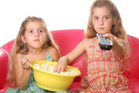 children watching a movie eating popcorn 写真素材
