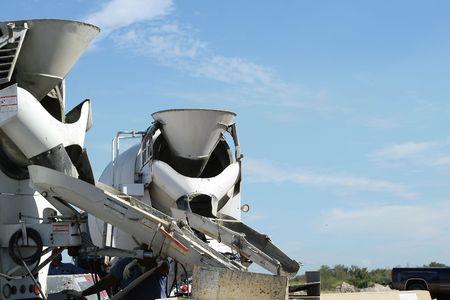 concrete: Concrete trucks pouring Stock Photo