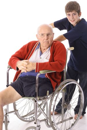 young boy pushing great grandfather in wheelchair
