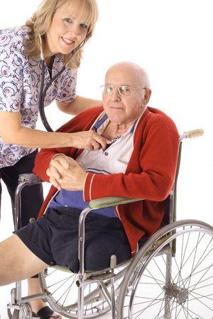 beautiful nurse taking care of elderly patient