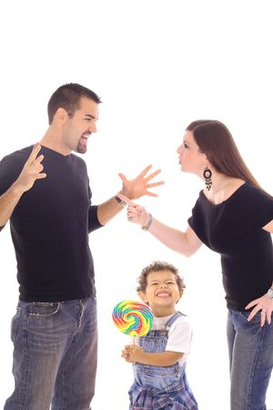 child with lollipop caught in the middle