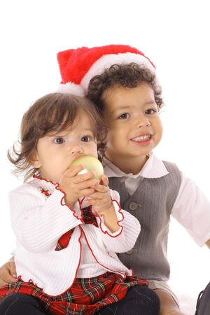 toddler in santa hat with sister photo