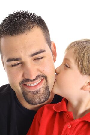 child kissing dad on the cheek photo