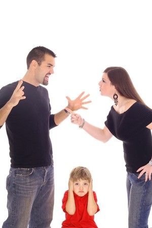 parents fighting and child stuck in between photo