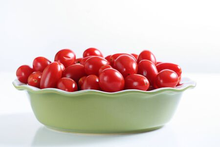 lycopene: grape tomatoes in a bowl on white