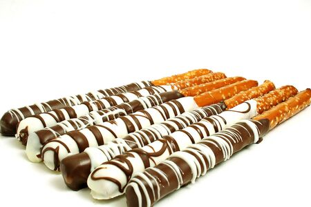chocolate pretzels on white photo