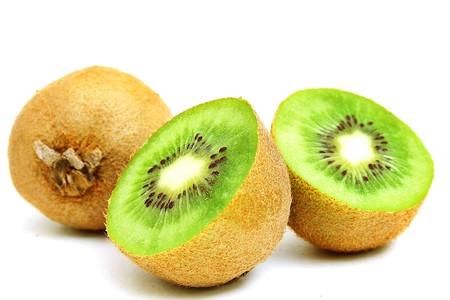 cut kiwi on white Reklamní fotografie