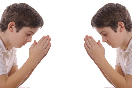 Twin brothers praying photo