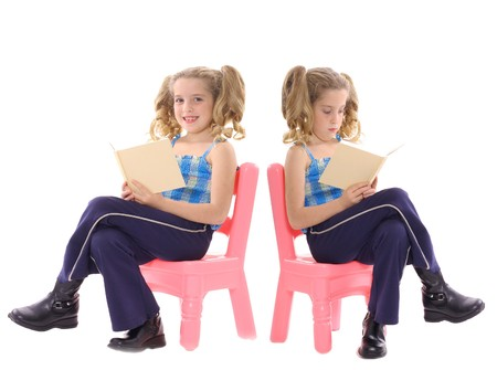 twins reading Stock Photo