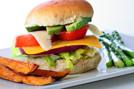 Veggie burger with sweet potato fries photo