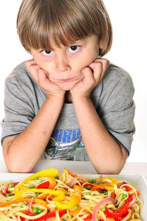 child with veggie pasta Reklamní fotografie