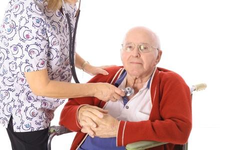 nurse checking elderly mans pulse photo