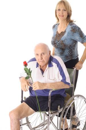 beautiful daughter pushing her elderly father photo