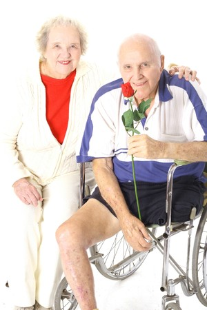 home health care: handicap man stoping to smell the roses Stock Photo