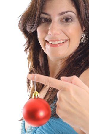 woman holding Christmas ornament upclose