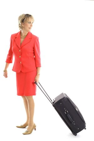 woman pulling luggage on white Reklamní fotografie
