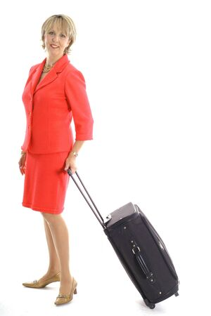 woman with luggage on white vertical Reklamní fotografie