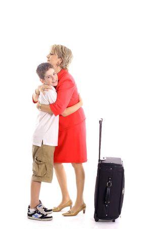 woman hugging boy leaving photo