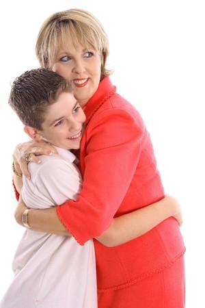 Woman hugging boy photo