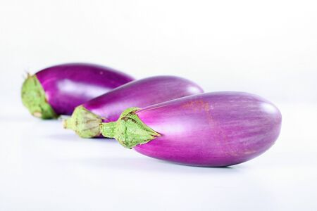 fresh from the garden eggplant on white