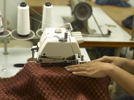 cloth manufacturing: A woman working on sewing machine