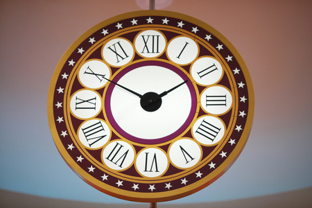 clock: A clock with Roman numerals. Stock Photo