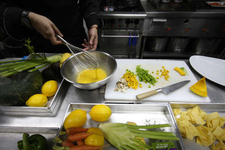 whisking: Chef was whisking the egg and preparing the food.