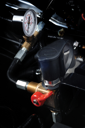 ngv: Gas pipeline and meter in car engine. Stock Photo