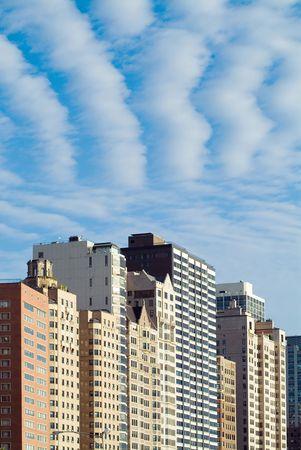 City skyline closeup with dramatic clouds photo