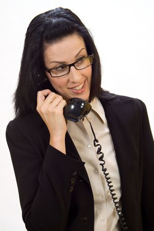 unsolicited: Woman holding an old school phone smiling Stock Photo