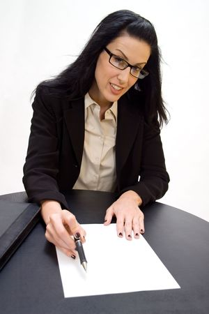 transact: Women holding pen pointing to blank document