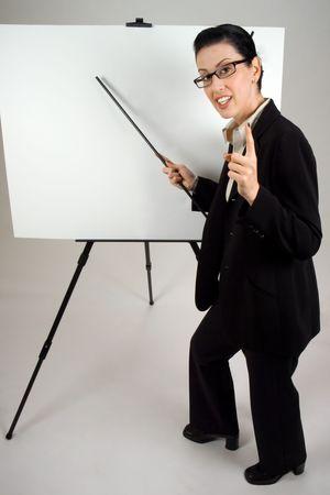 Female presenter with blank presentation whiteboard photo