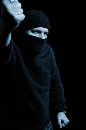 con man: Man covering his face holding up fist Stock Photo