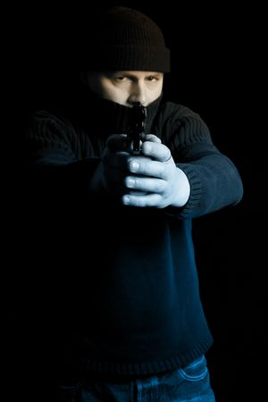 con man: Disguised gunman pointing handgun in your face Stock Photo