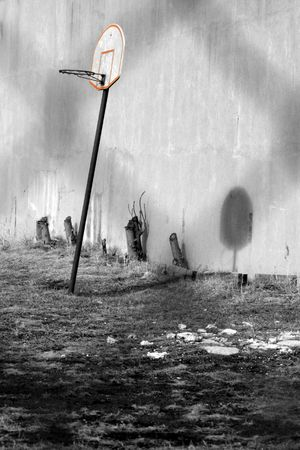Deserted basketball field in decayed urban environment photo